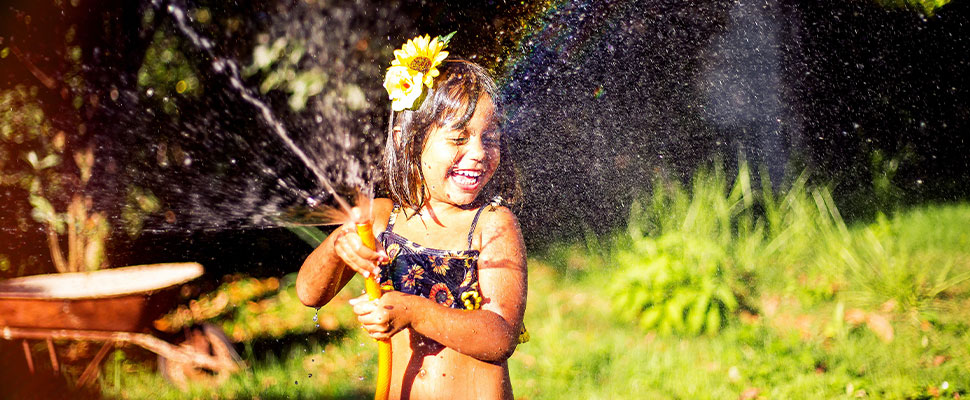 girl playing with a hose